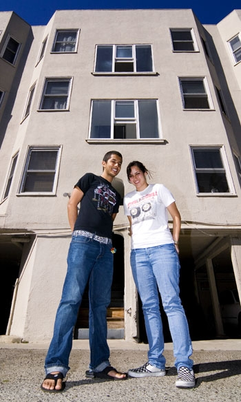 Photo: Jose Marquez and Heather Graviet stand in front of their apartment building at 2538 Durant Ave., which has been declared seismically unsafe by the city's Soft Story Ordinance.