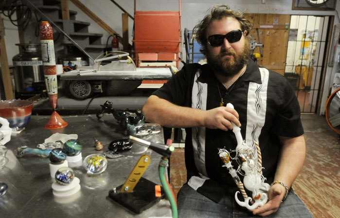 Photo: Dustin Revere's glass-blowing gallery may not be able to open on Telegraph Avenue because of a city zoning ordinance prohibiting any new stores that sell drug paraphernalia from obtaining a business permit.