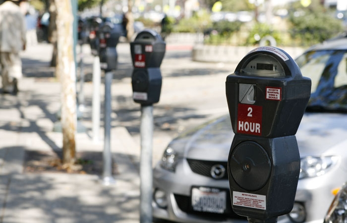 Photo: Parking meters on Adeline Street in Berkeley will not be used for six months following a city council decision. Shops hope the move will encourage customers to return to the area.
