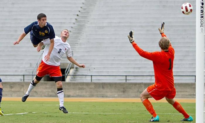 Photo: Cal defender Steve Birnbaum attacks the goal against Washington's Brad Keller. The No. 10 Bears, who lead the Pac-10, outshot the Huskies 9-3 in two overtimes of a 2-1 win.