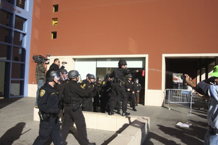Photo: UCPD pepper sprays protesters outside the UC Board of Regents meeting.