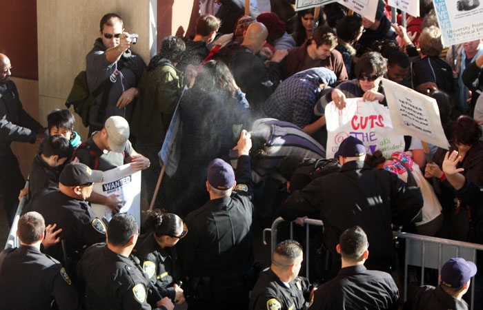 Photo: Protesters and police Officers clash outside of the Regents' meeting Wednesday. The meeting sparked these demonstrations because the Regents considered implementing an 8 percent fee hike.
