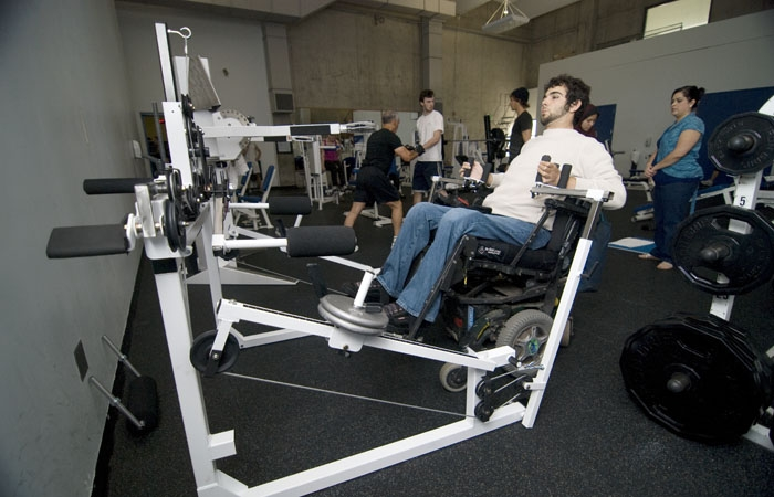 Photo: UC Berkeley senior Alex Ghenis works out on the RSF's new Uppertone system, a machine that enables individuals in wheelchairs to perform 16 different exercises without assistance.