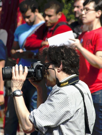 Photo: Professor Brian Barsky takes a picture of a protest on October 7, 2010. He leads a  seminar that introduces freshman students to both photography and current events.