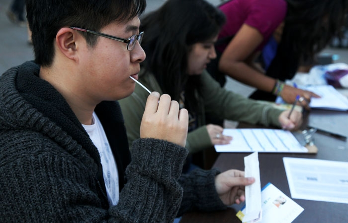 Photo: Charles Cheung registers to become a bone marrow donor by sending in a swab from his cheeks as a part of the