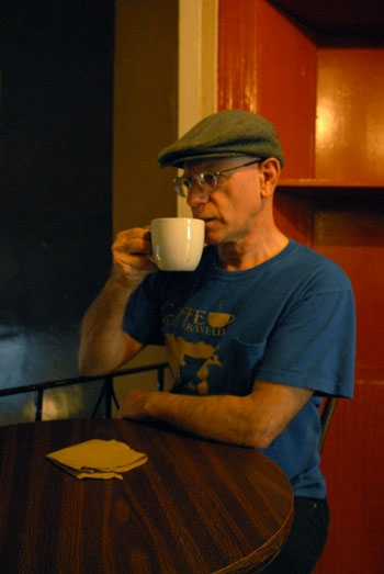 Photo: Craig Becker, the owner of Cafe Mediterraneum, enjoys a cup of coffee at the cafe. Some say the historic coffee spot was saved by Becker, who made it appealing to more customers.