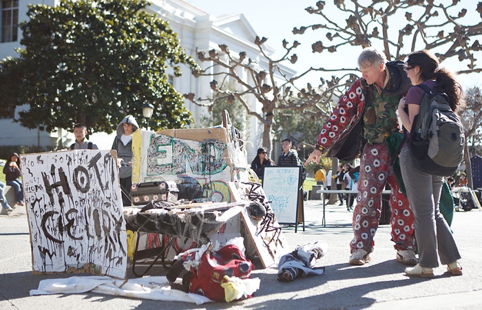 Photo: William Wollbrinck, a local 63-year-old man, uses costumes and art to perform on Sproul Plaza next to Sather Gate. He has preached his personal gospel on sunny days for 36 years.