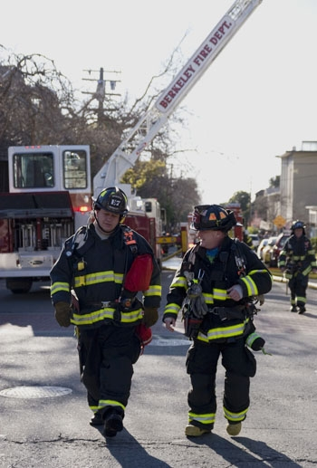 Photo: A fire burned the roof of an apartment building at the intersection of Haste Street and Telegraph Avenue Tuesday.