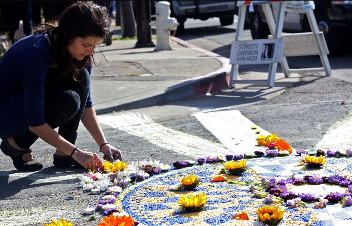 Photo: A Celebration of Life. Amber Nelson, the fiancee of the late Adolfo Ignacio Celedon, commemorates his life at the site of his murder in South Berkeley on Saturday. At the event, community members called for continued investigation into the unsolved case.