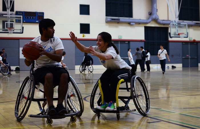 Photo: Two wheelchair basketball players compete during the Roll N' Shoot event at the RSF on Saturday.