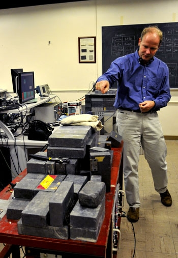 Photo: Kai Vetter, UC Berkeley associate professor-in-residence and staff scientist at Lawrence Berkeley National Laboratory, shows equipment used to test radiation levels in water and air.