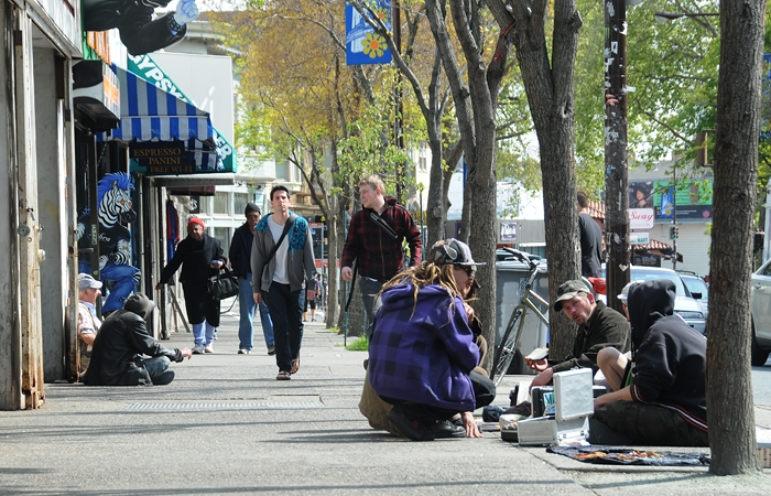 Photo: Locals sitting on Telegraph Avenue would be affected by a possible ordinance, which would make sitting or lying on sidewalks during business hours illegal.