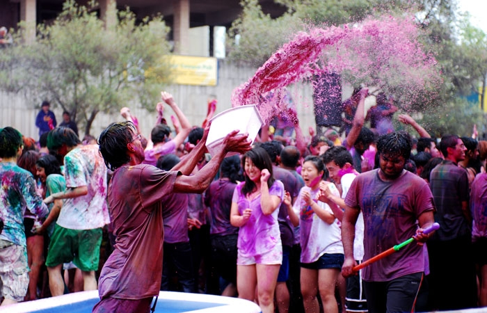 Photo: Despite the dawning of a grey day, about 1,500 people gathered to celebrate the Hindu holiday of Holi on UC Berkeley's Lower Sproul Plaza Sunday by painting each other in spatterings of rainbow powder, getting wet and dancing the day away.