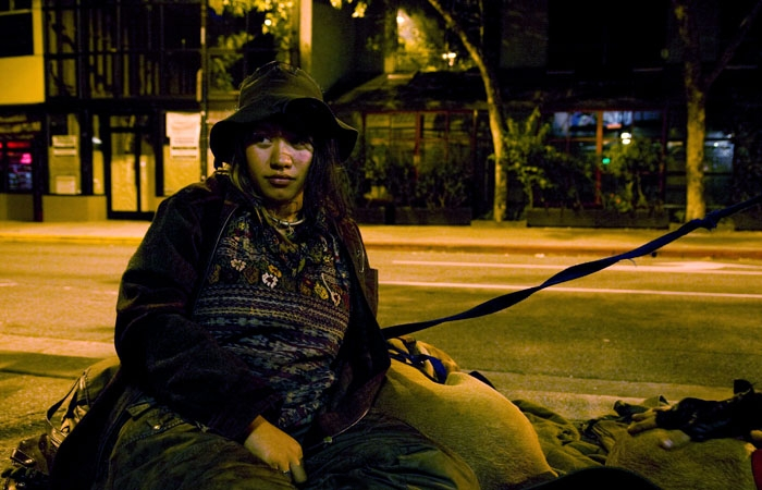Photo: Tonanzin Klote sits back on Telegraph Avenue. She will be disproportionately affected by the potential Sit-Lie Ordinance, which would make sitting on sidewalks illegal.