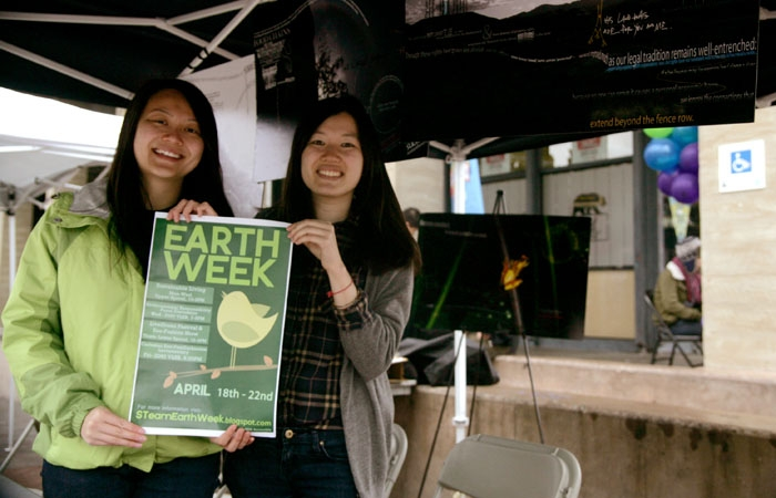 Photo: Michelle Choi and Michelle Lowe raise awareness about the environment in the week-long Earth Week celebration.