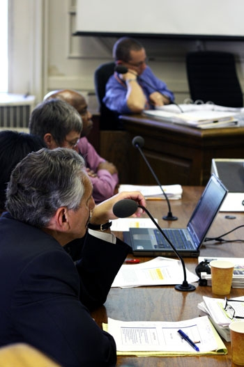 Photo: City Manager Phil Kamlarz (foreground) speaks regarding the budget proposal at the Berkeley City Council meeting Tuesday.
