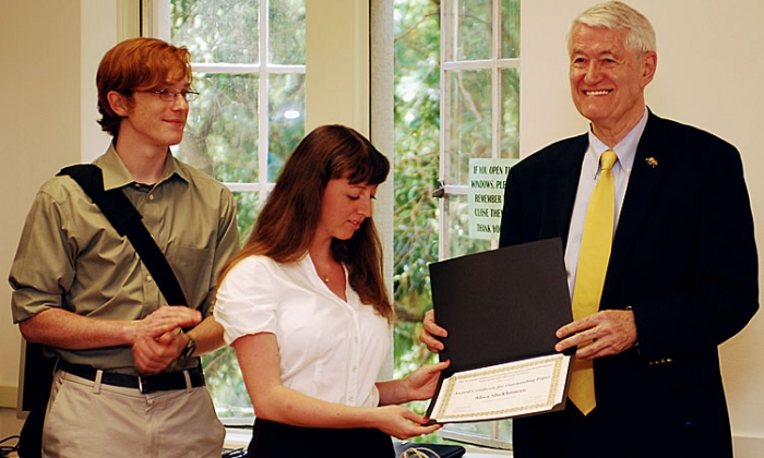 Photo: Chancellor Robert Birgeneau presents an award to a student.