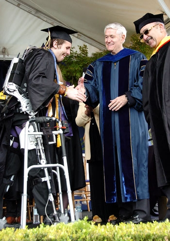 Photo: Austin Whitney, paraplegic for nearly four years, walked across the stage to receive his diploma.